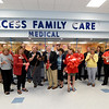 Representatives from Access Family Care and the Joplin Area Chamber of Commerce gather to celebrate the official opening of the clinic's new pediatrics and ob/gyn units with a ribbon cutting ceremony on Thursday at Access. The $1.3 million expansion added new 27 rooms to the clinic.<br /> Globe | Laurie Sisk