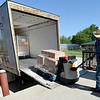 Ozarks Food Harvest driver Chad Baker, unloads a truck containing about 30,000 pounds of food last month at Crosslines.<br /> Globe | Laurie Sisk