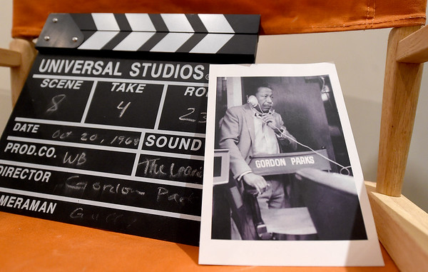 """A photo of Gordon Parks sits on his director's chair beside a clapperbord from his first major motion picture, """"The Learning Tree"""" at the Gordon Parks Museum in Fort Scott. Parks not only directed the film, he also wrote the screenplay, served as producer and composed the score for the movie.<br /> Globe 