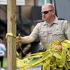 Jasper County Sheriffs Department Public Information Officer Tim Williams removes caution tape as Members of local law enforcement and the Springfield Fire Department Bomb Squad wrap up the investigation of a suspicious device on Thursday at the Royal Orleans Apartment Homes near Missouri Southern.<br /> Globe | Laurie Sisk
