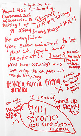 Messages of hope and dispair are included on laminated paper as part of Jaclyn Kidd's exhibit focusing on sexual abuse and assault.<br /> Globe | Laurie Sisk