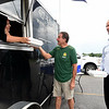 From the left: Jessica Tupper assists customers Rick Ham and Dan McCreary, both Missouri Southern alumni, during the Culver Creek Eatery's Moso Bogo event on Thursday at MSSU. Owner Jon Tupper contributed free sandwiches to students for each sandwich purchased on Thursday. Tupper said while campus food service was on break, he wanted to make sure that any students remaining on campus received a good meal. Any donations received were donated to Lion Co-op.<br /> Globe | Laurie Sisk