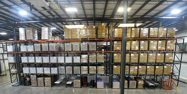 Columns of food are stacked inside one of two massive warehouses at Ozarks Food Harvest in Springfield last month.<br /> Globe   Laurie SIsk