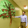 Ozarks Food Harvest CEO Bart Brown stands beside the Charles Foltz Gift of Time Tree that honors long serving volunteers. Volunteers are moved up the tree as they serve more hours. The tree is named in honor of longtime volunteer Charles Foltz.<br /> Globe | Laurie SIsk