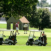 Golf enthusiasts flock to the links on a warm Wednesday at Schifferdecker Park.<br /> Globe | Laurie Sisk