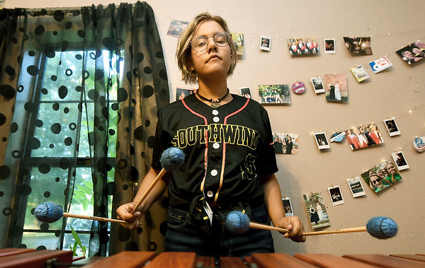 Webb City Hgh School senior Anna Struble stands behind her marimba on Thursday at her Oronogo home. Struble just completed her second year touring with the Southwind Drum and Bugle Corps of Mobile, Ala.<br /> Globe | Laurie Sisk