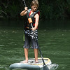 Adam Martinez, 12, of Carthage, gets a complimentary test drive of a Stand Up Paddleboard (SUP) courtesy of Joplin Kayak and Canoe on Saturday during the Shoal Creel Water Festival at Wildcat Glades.<br /> Globe   Laurie Sisk