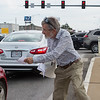 Elliott Denniston, Webb City, hands out information during a rally to stop the ongoing purge of eligible Missourians from the Medicaid program on Tuesday at 7th and Range Line Road.<br /> Globe | Roger Nomer