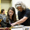 from the left: Samantha Krout and her father, Joe Krout, both of Tulsa, spend Samantha's 14th birthday looking through the vinyl for a Rick Springfield album during the 4 State Record Show on Saturday at the Jack Lawton Webb Convention Center.  More than 30 vendors of classic vinyl participated in the event.<br /> Globe | Laurie Sisk