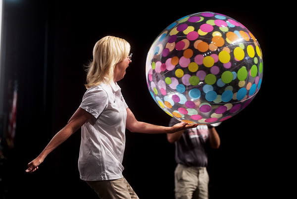 Joplin Superintendent Melinda Moss hits a beach ball into the crowd during Monday's back-to-school rally at Joplin High School.<br /> Globe | Roger Nomer