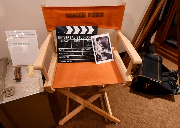 """A photo of Gordon Parks sits on his director's chair beside a clap board from his first major motion picture, """"The Learning Tree"""" at the Gordon Parks Museum in Fort Scott. Parks not only directed the film, he also wrote the screenplay, served as producer and composed the score for the movie.<br /> Globe   Laurie Sisk"""