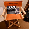 "A photo of Gordon Parks sits on his director's chair beside a clap board from his first major motion picture, ""The Learning Tree"" at the Gordon Parks Museum in Fort Scott. Parks not only directed the film, he also wrote the screenplay, served as producer and composed the score for the movie.<br /> Globe 