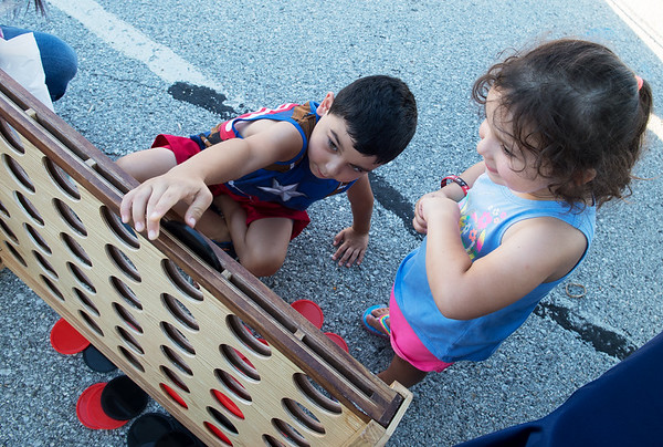 Miles, 6, and Nora, 3, Shead play a game of Connect Four during Carl Junction's Second Tuesday event.<br /> Globe | Roger Nomer