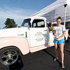 Kaylee Cristy, of Webb City, on Tuesday at Webb City High School stands beside the Joyfield Flower Truck that she and her sister, Kortlynn Burgess operate. The duo sell fresh cut flowers from the pink and white antique truck.<br /> Globe | Laurie Sisk