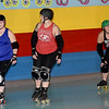"From the left: Mo_Kan Roller Girlz co-directors Megan Tyler, aka ""Roc"" and Melody McDannald, aka ""Mel Diablo"" and teammate Leray Caldwell warm up before practice for the Mo-Kan Roller Girlz on Thursday night at Spinning Wheels SK8 Center in Carl Junction.<br /> Globe 
