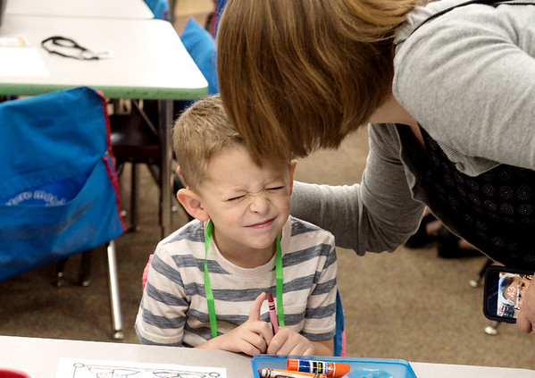 Oliver Hawkins gets a smooch from his mother Dani before his first day of kindergarten at Cecil Floyd Elementary on Thursday.<br /> Globe | Roger Nomer