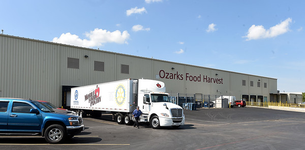 A truck prepares to load food for transport last month at Ozarks Food Harvest in Springfield.<br /> Globe   Laurie Sisk