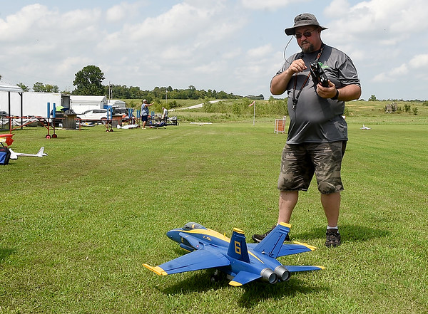OKRC Cloudbusters' Jared Clark, of Grove Oklahoma, warms up his Blue Angel F18C during the Sky Wings RC Club's Summer Fun Fly on Saturday in Webb City. The Sky Wings, who are members of the Academy of Modern Aeronautics, hosted more than 50 fliers from within a 100 mile radius of Webb City.<br /> Globe | Laurie Sisk