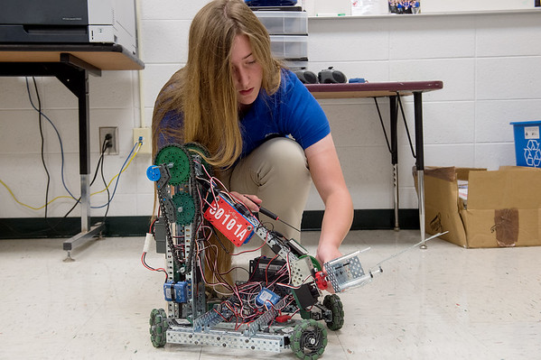 Ashley Stokes, a senior at Carl Junction High School, works on a TSA competition robot on Friday. Globe | Roger Nomer