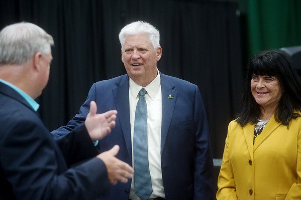 (from left) Darren Fullerton, vice president for student affairs,  Missouri Southern President Alan Marble and Paula Carson, provost and vice president of academic affairs talk during rehearsal for the First-Year Student Convocation at Leggett and Platt Athletic Center on Friday.<br /> Globe | Roger Nomer