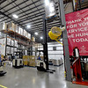 Workers at Ozarks Food Harvest in Springfield rotate inventory in one of two large warehouses last month.<br /> Globe | Laurie Sisk