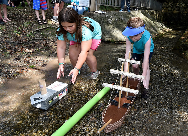 From the left: Amelia PArker, 8 and Dillon Dudley, 7, ;aunch their watercraft during the shoebox boat race on Saturday during the Shoal Creel Water Festival at Wildcat Glades.<br /> Globe | Laurie Sisk