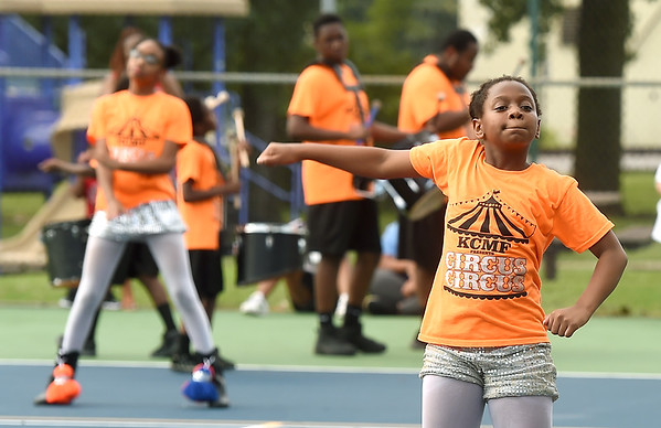 Nine-year-old JaLovely Fikes joins the other members of the award winning Kansas City Marching Falcons as they delight the crowd on Saturday night during the annual Emancipation Park Days at Ewert Park. The three-day event featured music, games, food and more.<br /> Globe | Laurie SIsk