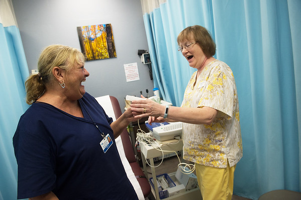 Llinda Flory, right, congratulates Sandy Conlee on a successful pulminary function test on Thursday at the Joplin Community Clinic.<br /> Globe | Roger Nomer