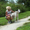 Kelly Johnson pets Riley before a run at the outdoor track at the Joplin Humane Society on Monday.<br /> Globe | Roger Nomer