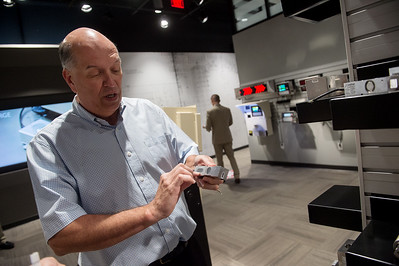 Larry Hicks, executive vice president of Cardinal Detecto, talks about a product in the company's new showroom on Friday. Globe | Roger Nomer