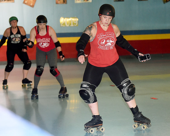 "Front to back: Melody McDannald, aka ""Mel Diablo"" leads Hannah Whitney, aka ""Sugar Rush""  ""  and Leray Caldwell, aka ""Ballz"" in a shuffle drill during practice for the Mo-Kan Roller Girlz on Thursday night at Spinning Wheels SK8 Center in Carl Junction.<br /> Globe 