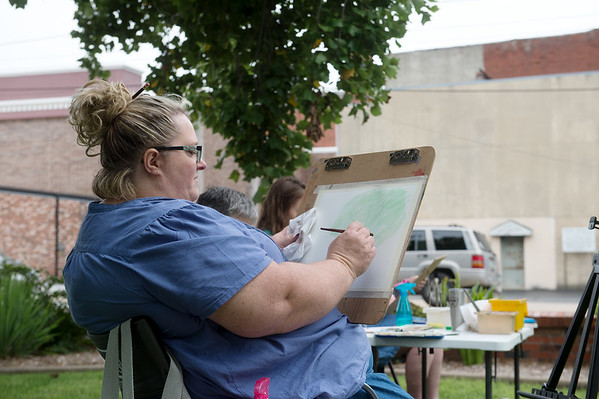 Shelly McIntyre, Joplin, joins the Plein Air Watercolor class, held by Spiva Center for the Arts, on Saturday in Spiva Park in Joplin.<br /> Globe | Roger Nomer