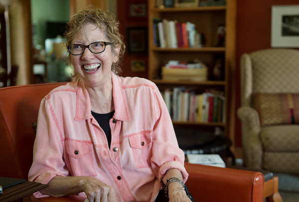 Jo Mueller talks about her experience attending Woodstock in 1969 during an interview on Tuesday in Carl Junction.<br /> Globe | Roger Nomer