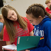 Rachel Case, left, and Jamie Fabozzi, both sophomores at Carl Junction High School, talk about a lab write up on Thursday.<br /> Globe | Roger Nomer