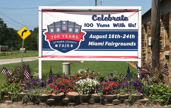 A sign at the entrance to the Ottawa Fairgrounds welcomes visitors to help celebrate the centennial of the fair.<br /> Globe | Laurie Sisk