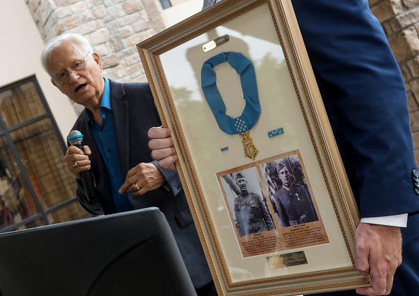 Allen Shirley presents a gift containing information about Sgt. York and replica Congressional Medal of Honor to the Joplin Community Based Outpatient Clinic on Friday.<br /> Globe | Roger Nomer