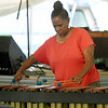 Arlecia Elkamil performs on the marimba on Friday night during the annual Emancipation Park Days at Ewert Park. The three-day event featured music, a car show, a church service and more.<br /> Globe | Laurie SIsk