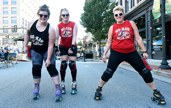 """From the left: Mo-Kan Roller Girlz roller derbyists Taylor Cunningham aka """"Peggy Kill,"""" of Joplin, Hannah Whitney, """"Sugar Rush,"""" of  Overland Park, Kan. and Leray Caldwell """" Ball Z,"""" of Nevada hit Third Thursday to promote their upcoming Mo-Kan Roller Girlz 12th Birthday Bash on Sept. 7 at Memorial Hall.<br /> Globe 
