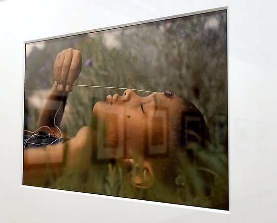 """Gordon Parks photo """"Boy with a June Bug,"""" hangs on a wall at the Gordon Parks Museum in Fort Scott. The photo was used for publicity for the movie """"The Learning Tree,"""" which Parks wrote, directed and composed the score for 50 years ago. The boy in the photograph is Fort Scott resident Claude Adams.<br /> Globe   Laurie Sisk"""