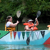 From the left: Lindsey Luebber and DeAnna Reed navigate their Camp Mintahama cardboard canoe down Shoal Creek on Saturday during the Shoal Creel Water Festival at Wildcat Glades.<br /> Globe | Laurie Sisk