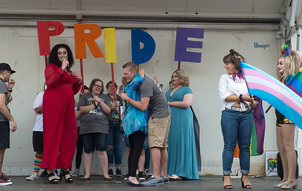 Ron Burch, co-chair of JOMO Pride, gets a hug from his mother Robin as he receives the Outstanding Community Leader award during Saturday's Downtown Diversity Pridefest in Joplin.
