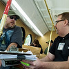 Jon Meyer talks with Robert Lolley, transit coordinator, about a transit survey on Wednesday.<br /> Globe | Roger Nomer