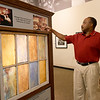 """Gordon Parks Museum's Executive Director Kirk Sharp stands near an exhibit of the old AME Church in Fort Scott, where scenes from Parks' """"The Learning Tree"""" were filmed in 1968.<br /> Globe 