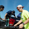 Cooper Anderson, a Missouri Southern sophomore from Osceola, left, and Fisher Friend, a MSSU junior from Webb City, right, help Reed Service, a MSSU junior from Tampa, Fla., move into a residence hall at MSSU on Thursday. Anderson and Friend are part of the Kappa Alpha Order, one of several campus groups volunteering during moving day at MSSU.<br /> Globe | Roger Nomer