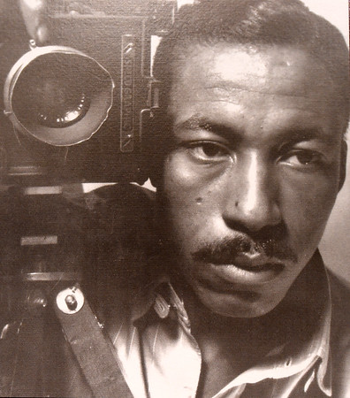 """On a display at the Gordon Parks Museum in Fort Scott, poet, author, photojournalist, composer, filmmaker and professional basketball player Gordon Parks is pictured with his first camera, one he purchased """"as a weapon against all the things I dislike about America - poverty, racism, discrimination."""" Parks first major film """"The Learning Tree"""" will celebrate its 50th anniversary this year at the museum during the !6th Annual Gordon Parks Celebration Oct. 3-5.<br /> Globe 