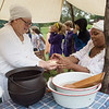 Amber Hallacy, left, and Brenique Brown prepare an Irish Stew while at the Crawford County Historical Museum on Friday for Little Balkans Days.