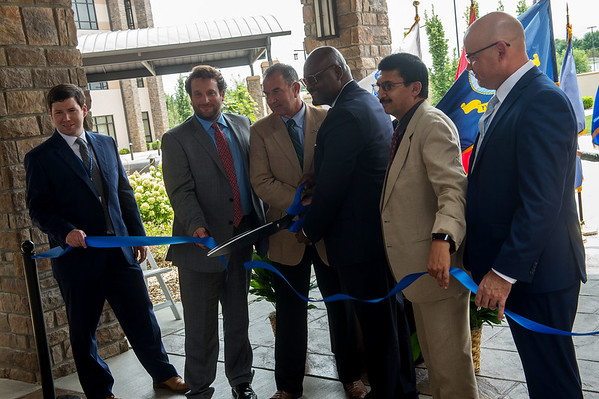 The ribbon is cut for the Joplin Community Based Outpatient Clinic on Friday.<br /> Globe | Roger Nomer