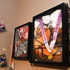 Relics of two years of touring hang on Anna Struble's bedroom wall inside her Oronogo home. The Webb City High School senior just completed her second year touring with the Southwind Drum and Bugle Corps of Mobile, Ala.<br /> Globe | Laurie Sisk