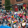 Participants in Saturday's 2019 Downtown Diversity Pridefest march along Joplin Street, commemorating the 50th anniversary of the Stonewall Riots.<br /> Globe | Roger Nomer