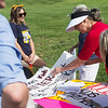 Stephanie Clarke, Joplin, selects a sign for a rally to stop the ongoing purge of eligible Missourians from the Medicaid program on Tuesday at 7th and Range Line Road.<br /> Globe | Roger Nomer